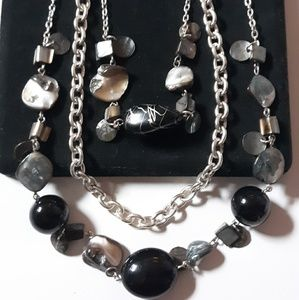 Multi strand necklace with matching earrings